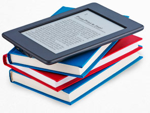 A stack of print books with an e-reader on top.